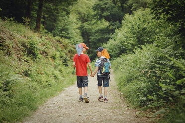 Two boys walking hand in hand with dip nets - NMSF00068