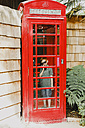 Boy in a red phone box - NMSF00071