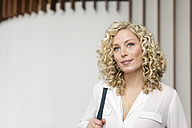 Portrait of smiling blond businesswoman - PESF00524