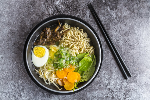 Bowl of ramen soup with spinach, carrot, boiled egg, bamboo sprouts and mushrooms - SARF03316