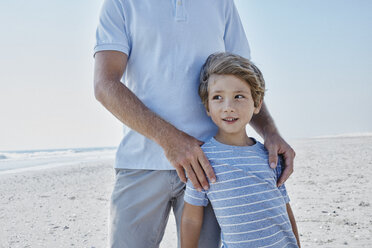 Boy with his father on the beach - RORF00768