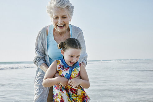 Happy grandmother with granddaughter on the beach - RORF00786