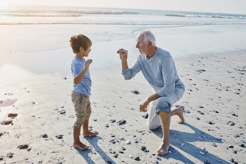 Grandfather and grandson on the beach - RORF00798