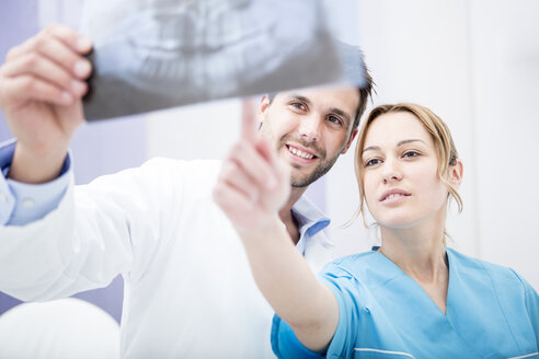 Two doctors discussing dental x-ray image - WESTF22985