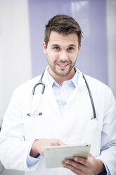 Portrait of smiling doctor using tablet - WESTF22991