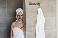 Portrait of woman wearing towels in the bathroom - CHPF00395