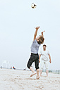 Father and little son playing with ball on the beach - MVCF00155