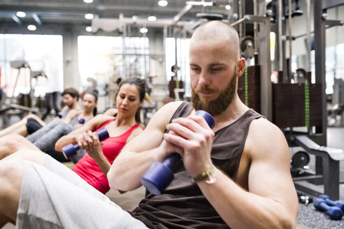 Group of athletes exercising with dumbbells in gym - HAPF01620