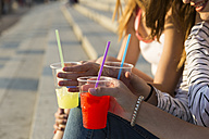 Three young women with soft drinks, partial view - KKAF00732