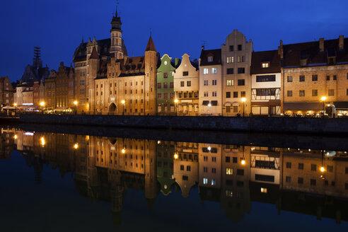 Poland, Gdansk, skyline at Motlawa bank with river reflection - ABOF00181