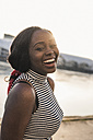 Portrait of a laughing young woman - UUF10542