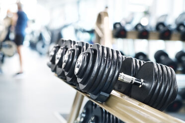 Close up of dumbbells in gym - HAPF01668