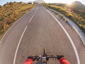 Spain, Andalusia, Cabo de Gata, personal perspective of cyclist on a street - LAF01829