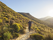 Spain, Andalusia, Cabo de Gata, back view of man hiking - LAF01835