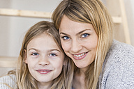Portrait of smiling little girl with her mother - TCF05388