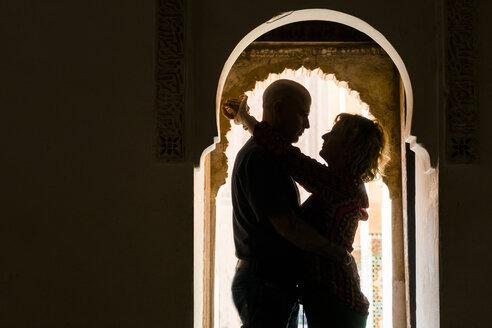 Morocco, Marrakesh, couple hugging in doorframe - KKAF00769