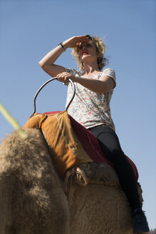 Morocco, woman on a camel - KKAF00808