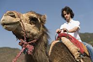 Morocco, man on a camel - KKAF00811