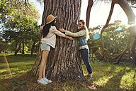 Two best friends hugging tree - SRYF00429