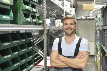 Portrait of smiling man in warehouse - LYF00705