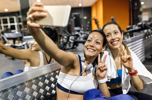 Two women making a selfie after work out in the gym - MGOF03261
