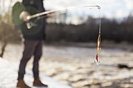 Man fishing in winter - KNTF00840