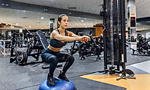 Woman working out in gym - MGOF03298