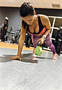 Woman working out in gym - MGOF03301