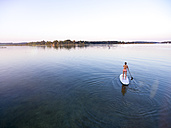 Germany, Bavaria, Chiemsee, woman on SUP Board - MMAF00068