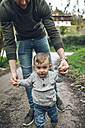 Father leading little boy on path - DAPF00721