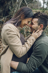 Man with smiling pregnant woman in nature - DAPF00745