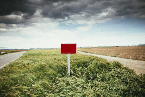 Spain, Lleida, sign in a field - JPF00187