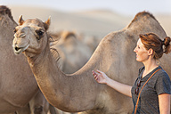 UAE, woman with a camel - MMAF00087