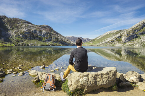 Spain, Asturias, Picos de Europa National Park, man sitting at Lakes of Covadonga - EPF00438