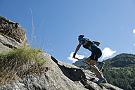 Italy, Alagna, trail runner on the move near Monte Rosa mountain massif - ZOCF00257