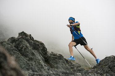 Italy, Alagna, trail runner on the move near Monte Rosa mountain massif - ZOCF00272