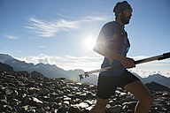 Italy, Alagna, trail runner on the move near Monte Rosa mountain massif - ZOCF00275