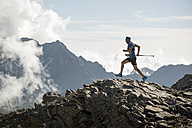 Italy, Alagna, trail runner on the move near Monte Rosa mountain massif - ZOCF00278