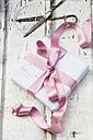 Scissors and Christmas present on wood - LVF06087