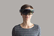Woman wearing mixed reality smartglasses - RBF05664