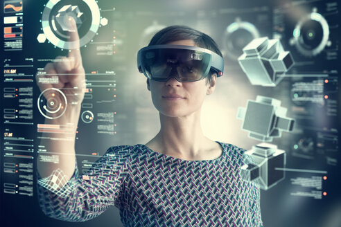 Woman wearing mixed reality smartglasses touching transparent screen - RBF05667
