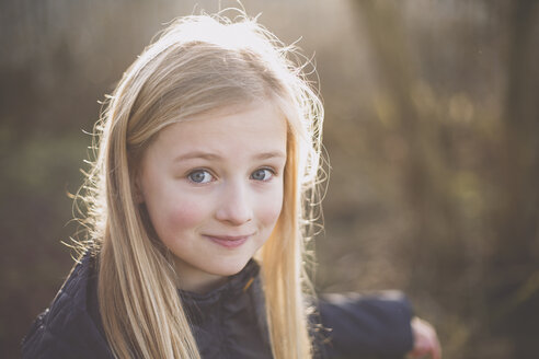 Portrait of a smiling girl outdoors - NMSF00080