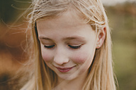 Portrait of a smiling girl outdoors - NMSF00095