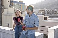 Friends having a drink on a rooftop terrace - WESTF23102