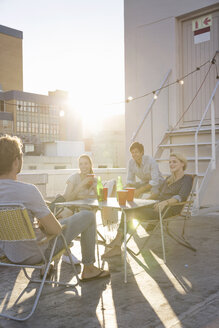 Friends having a rooftop party on a beautiful summer evening - WESTF23129