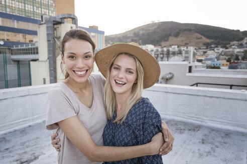 Friends having fun on a rooftop terrace - WESTF23138