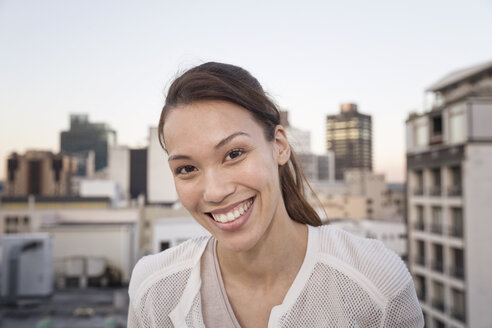 Young woman standing, smiling, portrait - WESTF23141