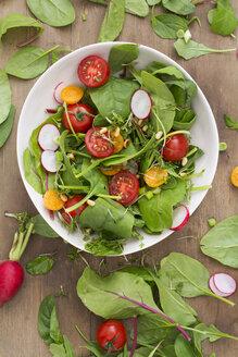 Bowl of mixed salad on wood - ODF01491