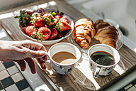 Strawberries, croissants and coffee in kitchen - JOSF00776