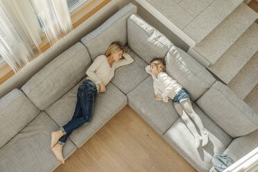 Mature woman and girl at home lying on couch - JOSF00800